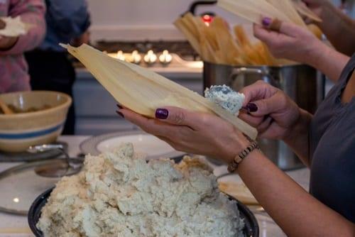 Spreading masa on corn husks