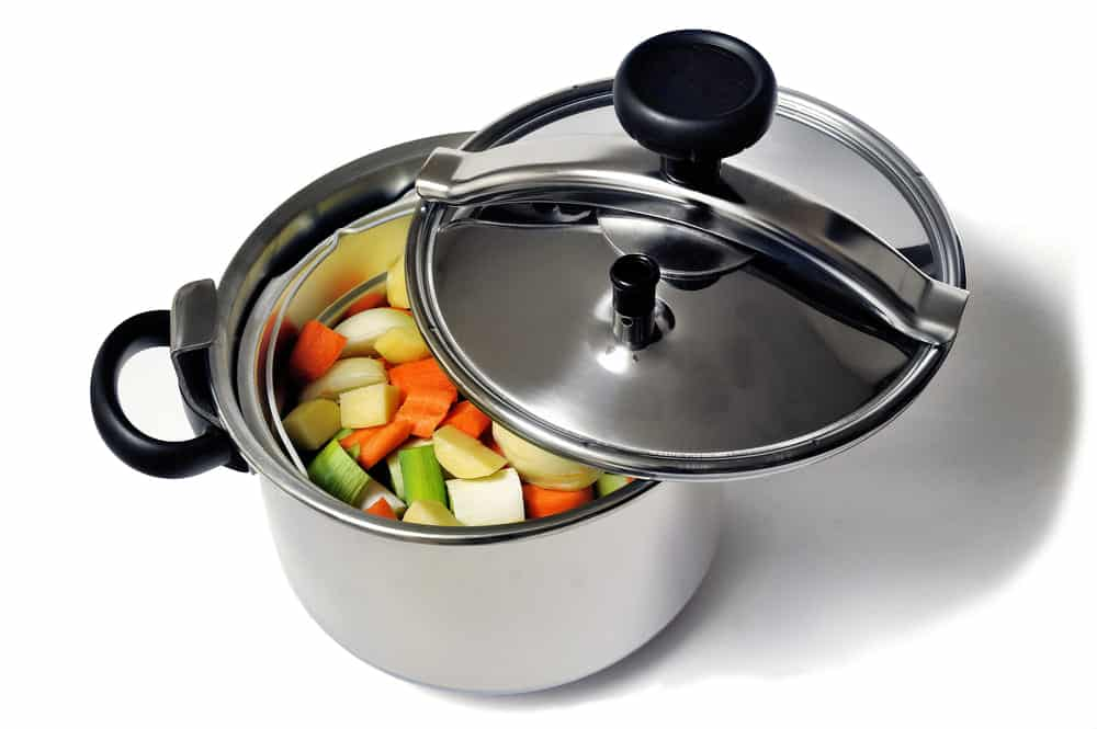 why does it take less time to cook vegetables in a pressure cooker