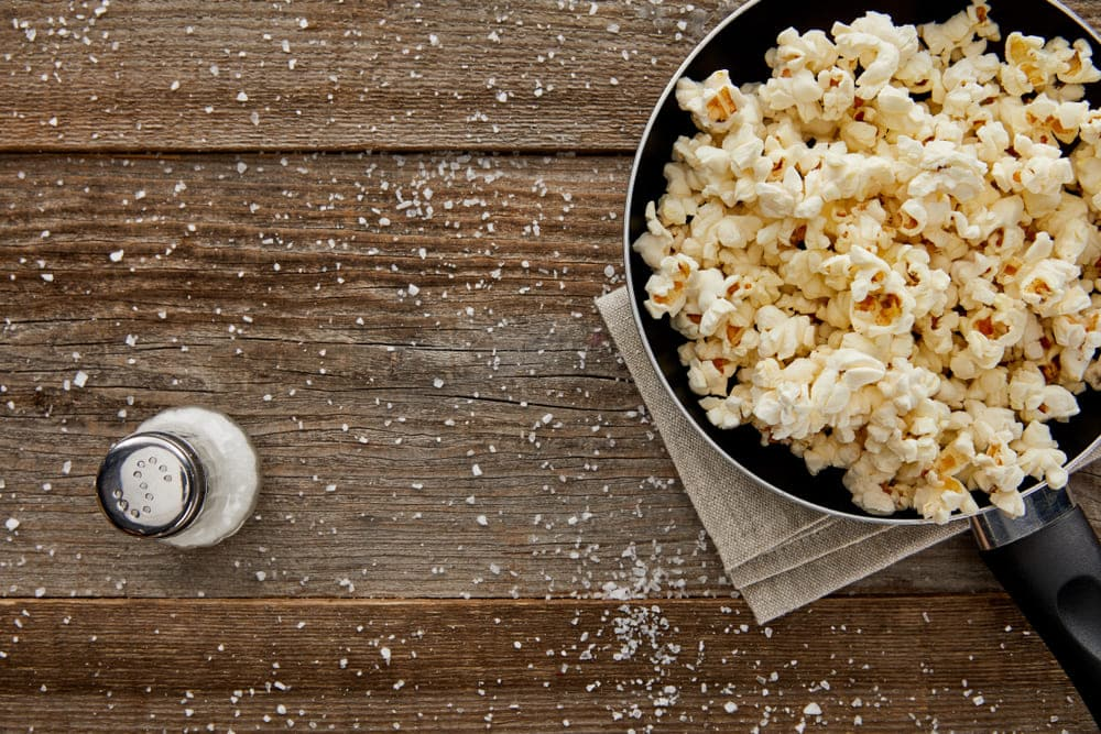 how to get seasoning to stick to popcorn